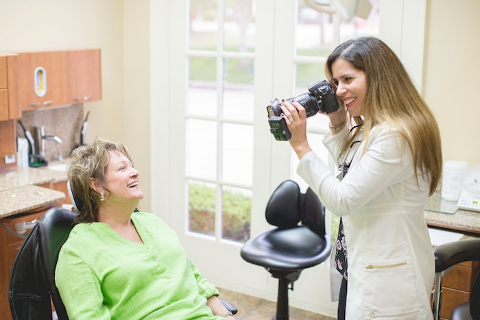 Dr. Jelsing using a professional camera to take photo of one of your patients