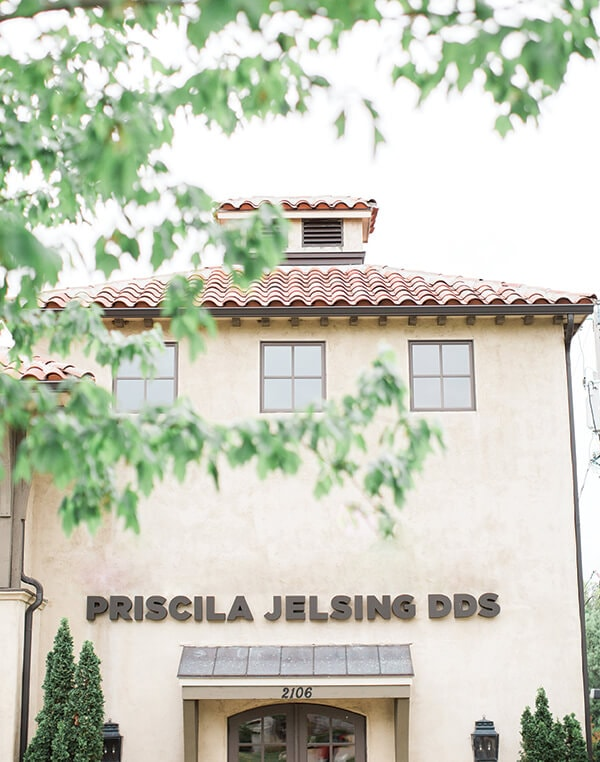 "The outside of our office with the sign above the door saying, ""Priscila Jelsing DDS"""