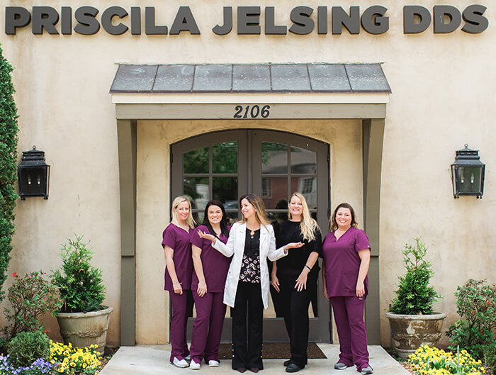 The Atlanta Place Dentistry team standing outside our office and smiling